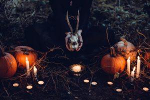 Goat skull, pumpkins and candles