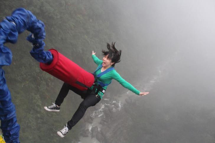 Bungee jumping girl yelling