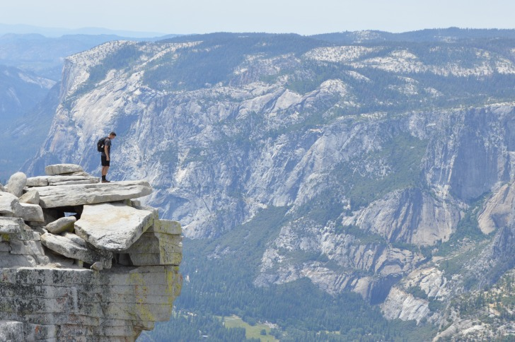 Man standing on the edge of canyon
