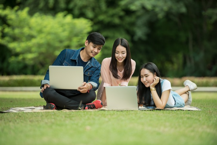 Boy and two girls with laptops