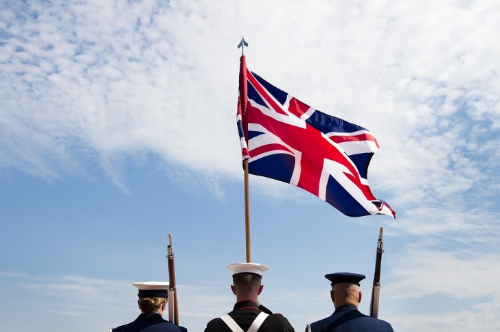 Soldiers holding the British flag