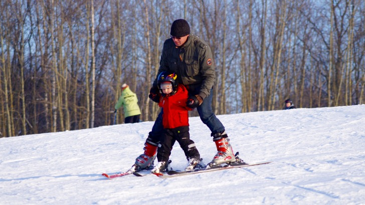 Man skiing with a kid